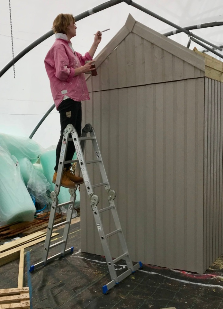 Alex painting the shed for the Sparsholt show garden, for RHS Chelsea Flower Show 2019.